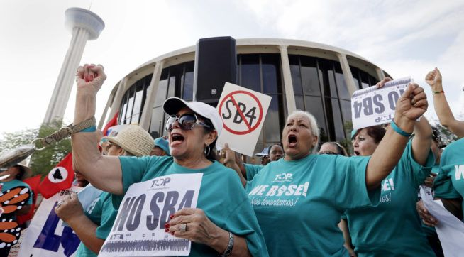 "#Media #Oligarchs #MegaBanks vs #Union #Occupy #BLM #SDF #Humanity  Federal Judge Blocks Texas' Tough 'Sanctuary Cities' Law  http://talkingpointsmemo.com/news/federal-judge-blocks-texas-sanctuary-cities-law  A federal judge late Wednesday temporarily blocked most of Texas' tough new ""sanctuary cities"" law that would have let police officers ask people during routine stops whether they're in the U.S. legally and threatened sheriffs with jail time for not cooperating with federal immigration…"