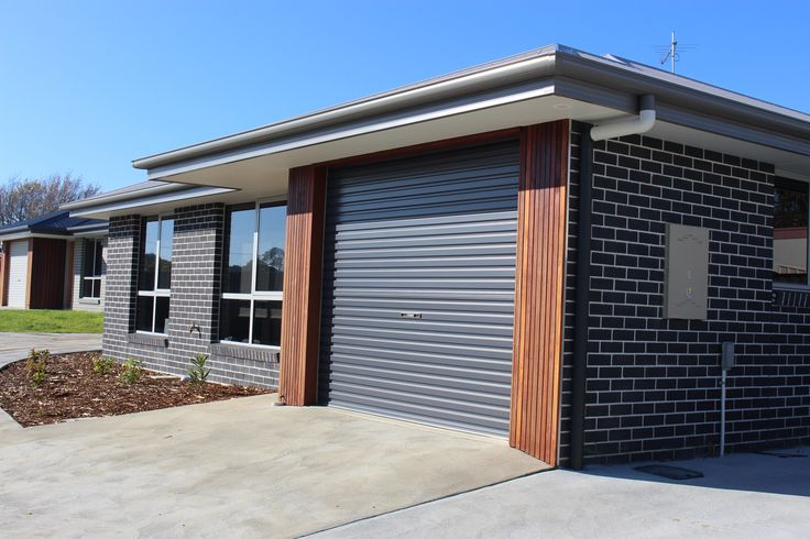 Modern brick home using Bricks for the Future in Graphite colour - offset with timber panel detail