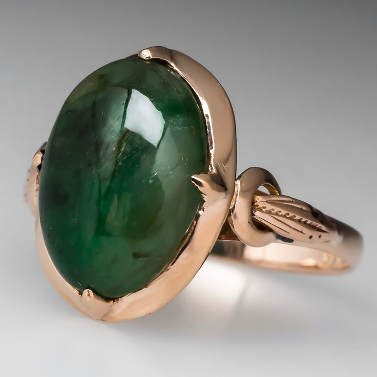 Handmade Vintage Jadeite Jade Ring 18K Gold - This incredible handmade jadeite jade ring is crafted of solid 18k yellow gold. The jade has a shinning halo of gold surrounding it with a hand pierced under gallery and molded shoulders.