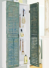 SHUTTER CABINET    	    The Basics: Salvaged green shutters become doors for this laundry room utility cabinet. I need to do this for the broom closet I want to do on the end of the cabinets in the kitchen!