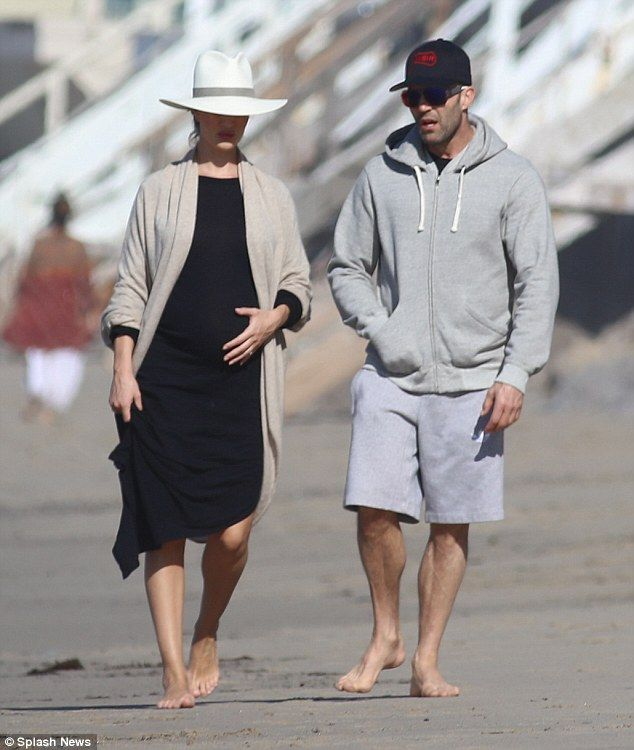 This is the life:Rosie Huntington-Whiteley enjoyed a year off from the Met Gala, swapping NYC for Malibu as she hit the beach for a relaxing day with her fiance Jason Staham on Monday