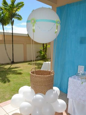 hot air balloon themed blue sky baby shower giant hot air balloon baskets made of balloons and fish netting and white balloons as base for clouds