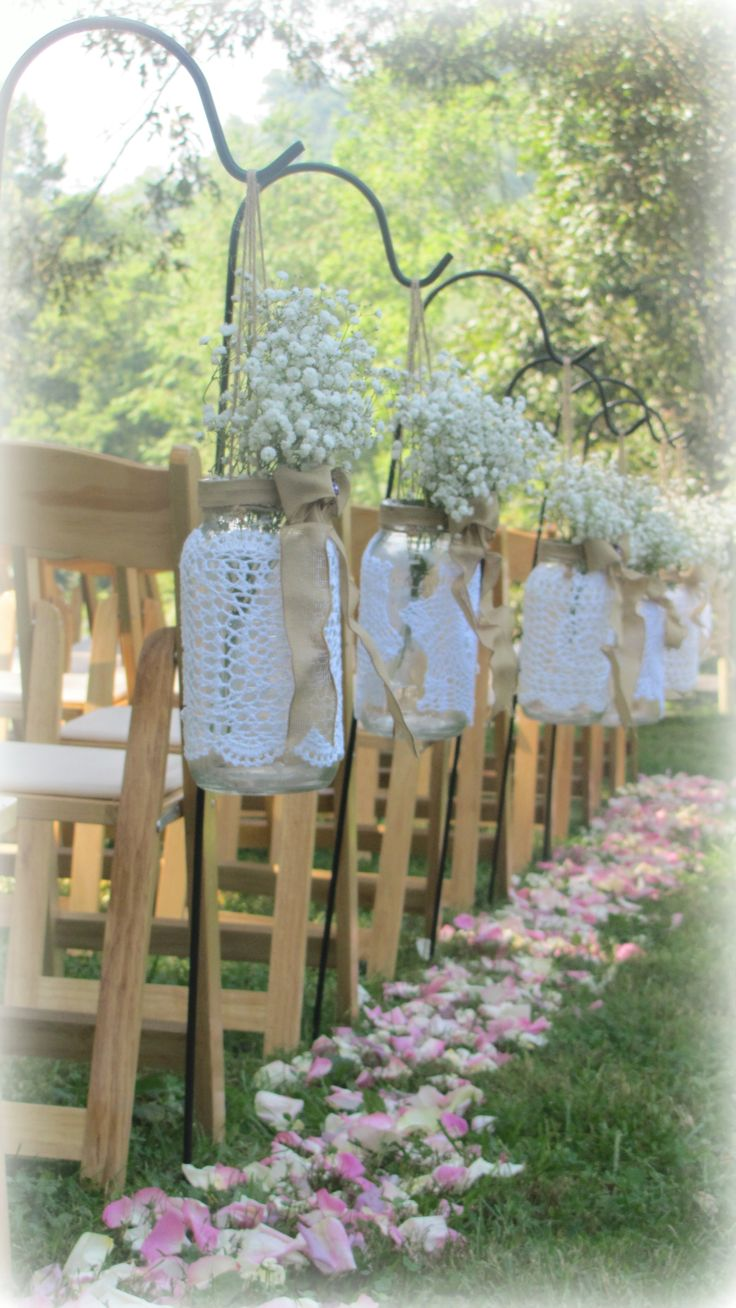 Perfect Pastel Petals & Rustic Baby's Breath Mason Jars line the isles of this outdoor ceremony.  Our most recent wedding & one of our favorites!