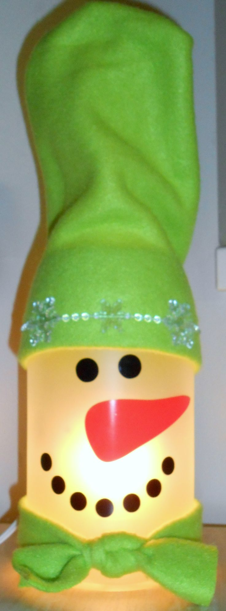 Bottle snow-person with fleece hat and scarf. Created by Karen Bennett