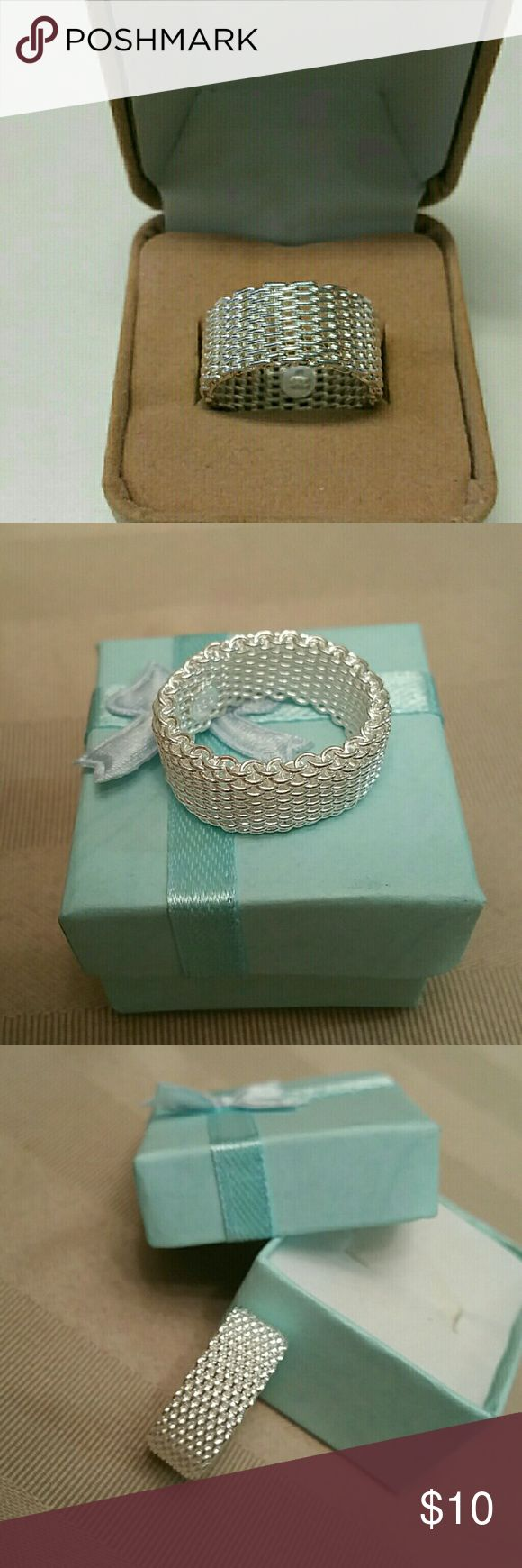 NWT STERLING SILVER MESH BAND 7 NWT ladies sterling silver (#925) mesh band. Uniquely designed and beautiful detailing makes this ring a eye catcher. Gift box included size 7 Jewelry