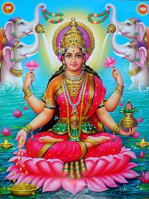 Lakshmi ~ Goddess of light.  I am so drawn to Lakshmi- Ganesha (son of Shiva) in the background usually depicted with her as he adores her.