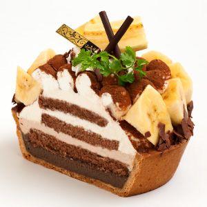 Banana Tiramisu Tart.  tart of chocolate mascarpone cream + chocolate sponge containing plenty of coffee syrup + banana slices