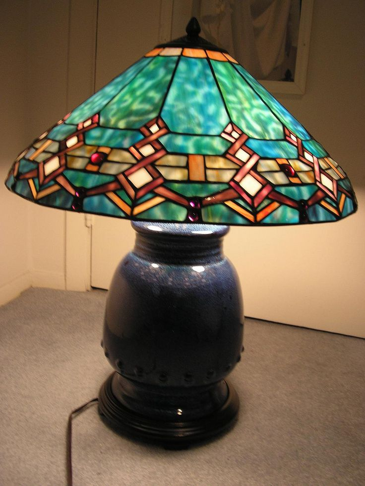 https://flic.kr/p/5PgR1j | FOR SALE: Tiffany Style Turquoise Southwestern Stained Glass Lamp | PRICE: $300 Tiffany Reproduction Stained Glass Style Table Lamp - Turquoise Southwestern. Tiffany Style stained glass lamp with a southwestern theme. The shade is 20 inches in diameter - total height of lamp shade is about 10 inches high. Base has 3 light sockets (up to three 60 watt bulbs) and is made of blue stoneware. On -Off switch on plug. This lamp is in EXCELLENT condition – no cra...
