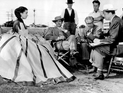 Clark Gable,Vivien Leigh,Victor Fleming and the producer David O.Selznick on the set of Gone with the wind(1939)
