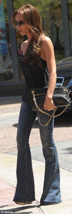Victoria Beckham... love the attire.. the boot-cut jeans, black clingy singlet, and the nude wedges.