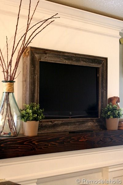 Frame a flat screen tv...love the rustic wood look...so doing this!!