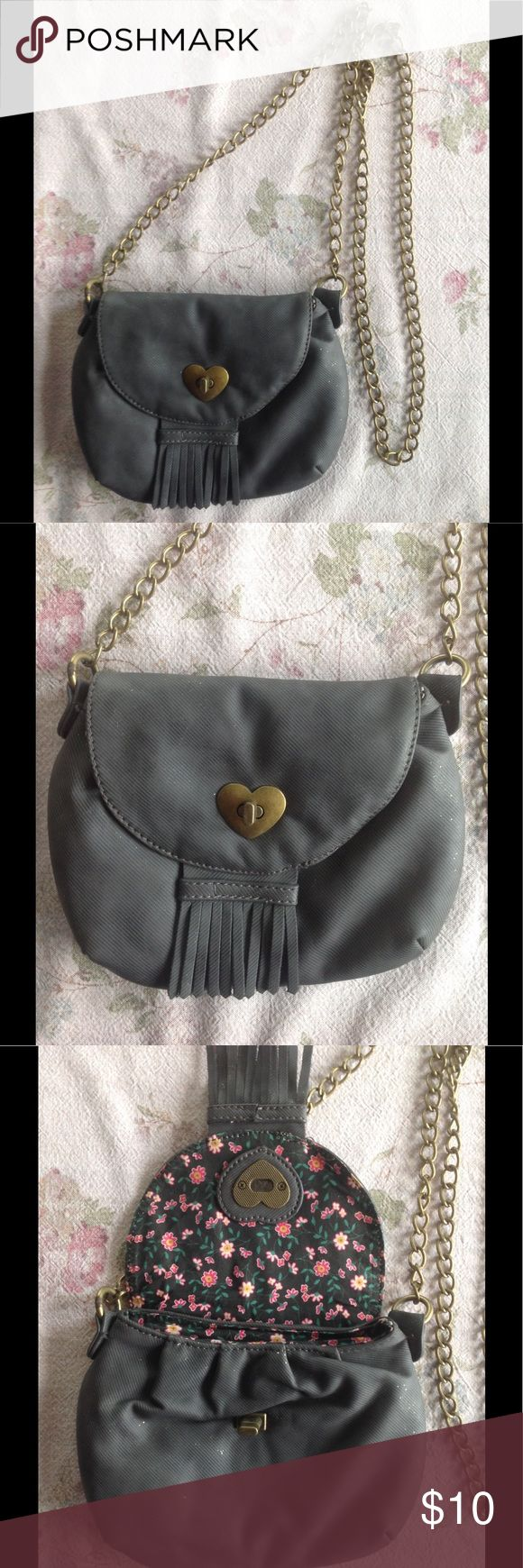 ✨American Rag Small Cross Body Bag Sparkly Gray✨ This small cross-body bag is 6inx7.5in and hangs on a gold chain. Originally purchased from Macy's. only used once. Body is dark gray with scattered sparkles and 100% PU/by cast leather. Interior is a pretty floral print and has one zip pocket inside. Great condition! Check my other listings for great brand names. ✨Make an offer and check my other listings for more deals on brand name clothing!✨ American Rag Bags Crossbody Bags