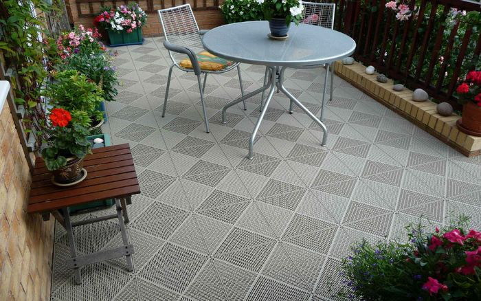 patio with interlocking deck tiles gray on grass google