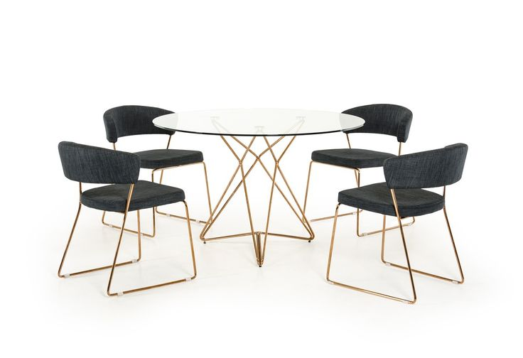 """Modrest Ashland Modern Glass Round Dining Table. a dainty 10mm round tempered clear glass top perched on a polished ?star-shaped? stainless steel frame with a shiny rose gold finish. This modern glass round dining table seats 4 comfortably, has a dimension of W47"""" x D47"""" x H30"""", and requires some assembly. $578USD  www.modernmiami.com"""