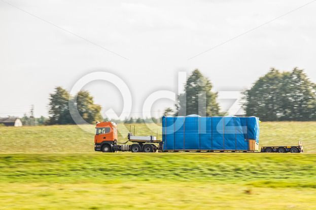 Qdiz Stock Photos | Truck on the country road,  #automobile #autotruck #business #car #cargo #commercial #delivering #delivery #driving #fast #freight #highway #industry #land #lane #logistic #lorry #merchandise #motion #motor #motorway #moving #oversized #road #shipping #speed #thoroughfare #trailer #transport #transportation #truck #trucking #vehicle #wagon