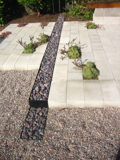 Install a French drain. If a rain garden just isn't right for your lifestyle or the layout of your landscape, a French drain might be the wa...