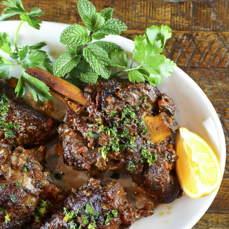 Lamb shanks braised in wine & aromatics osso buco style makes for an easy & delicious special occasion meal. Garnish with lemon, orange & mint gremolata.