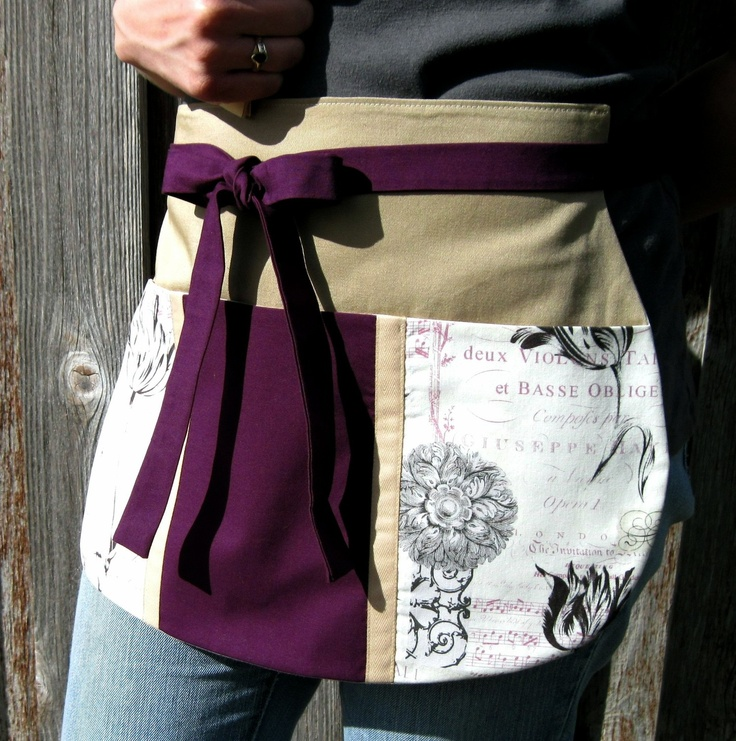 Plum and Parchment Utility Half Apron for Music Lovers, Crafters and Music Teachers -- Craft Apron -- Utility Apron -- Vendor Apron. $25.95, via Etsy.