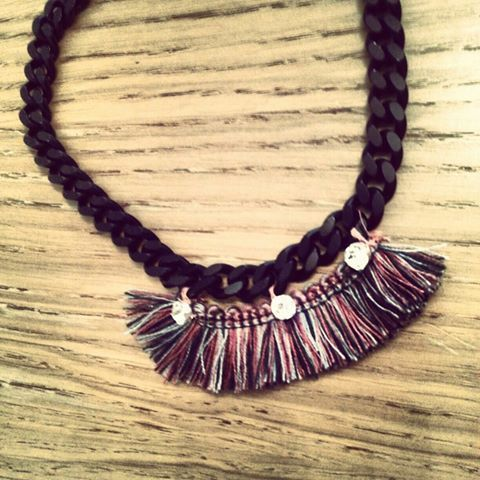 Artist Niki Taliadourou Black chain African style neckless with semiprecious crystals and traditional color yarns.