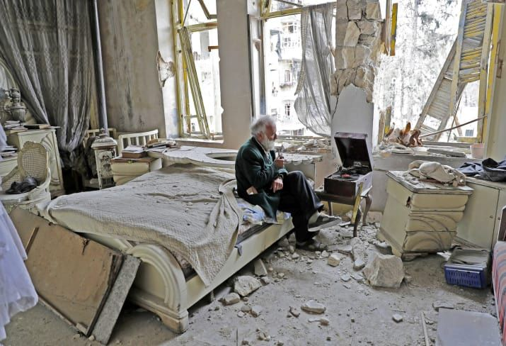 This powerful image of Anis, sitting in the rubble-strewn ruins of his family home, smoking his pipe, and listening to his vinyl records in a city ravaged by years of civil war, was taken by AFP's Joseph Eid. Eid, a Beirut-born photographer, told BuzzFeed News he wanted to track down Anis to see how he was doing several months after his AFP colleague wrote about him during the deadly siege of eastern Aleppo. 'We searched for him in the neighborhood, we asked about him to the residents there…