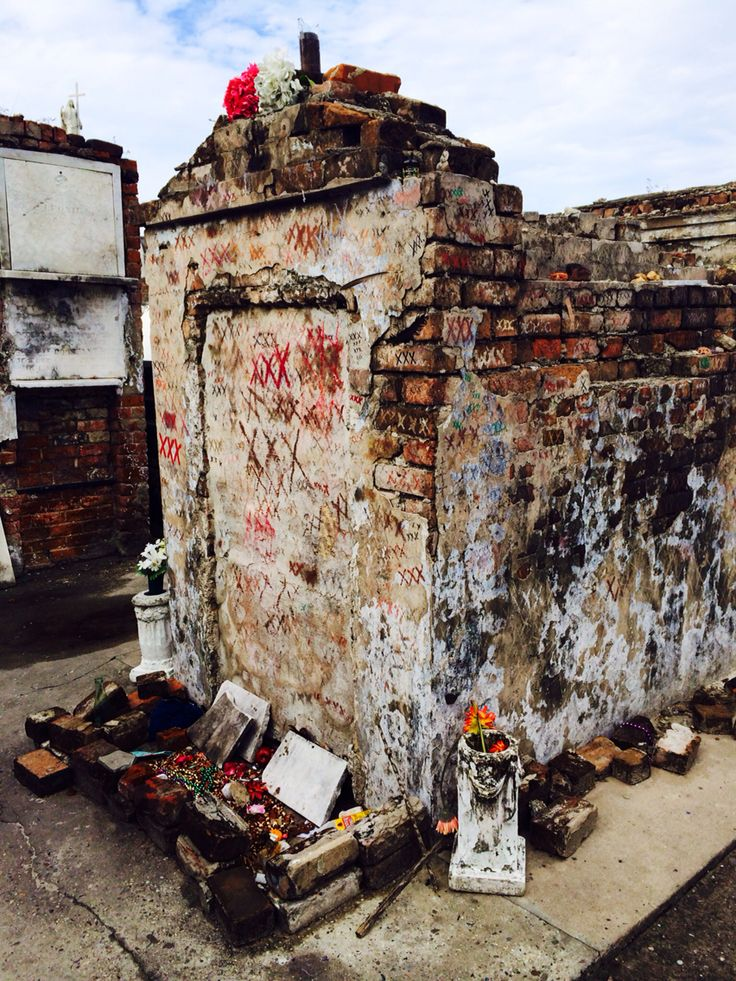 Tomb marked with XXXs (voodoo tradition) in St Louis Cemetery 1. Wrongly associated with Marie Laveau, the Voodoo Priestess.