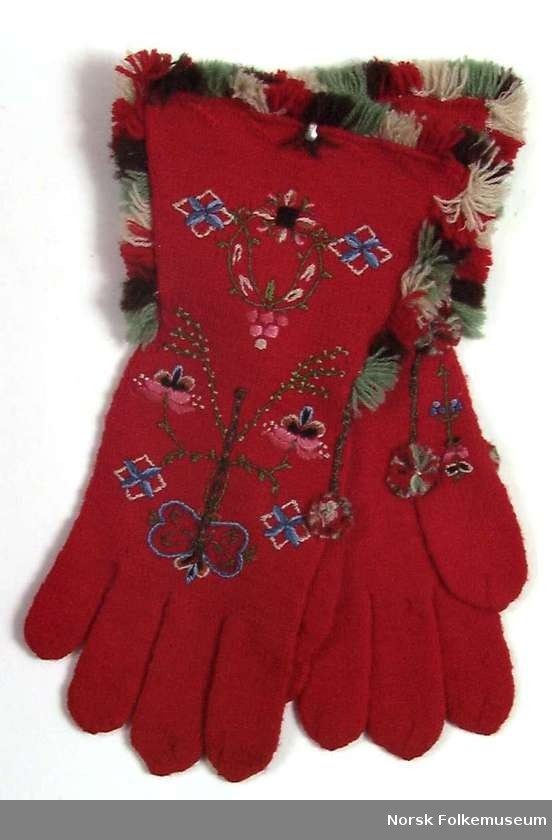 Late-1930s red Norwegian knitted and embroidered gloves with multi-color fringe. Photo: Norsk Folke Museum