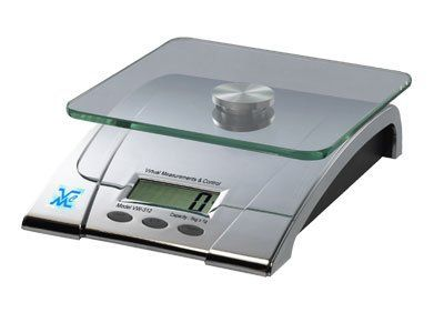 """VMC Glass Weighing Platter Digital Kitchen Scale by VMC. $45.00. Size: 9.5""""L x 7.5""""W x 1.1""""H. Measure out the proper food portions for your recipes.. The all purpose Digital Kitchen Scale is perfect for those who are watching their weight.. Converts kg, lbs, and g. Requires a 9V battery (not included).. Color: Stainless Steel. With a large LCD display, the VMC Glass Weighing Platter Digital Kitchen Scale comes with a high precision strain gauge sensor. It features auto shut of..."""