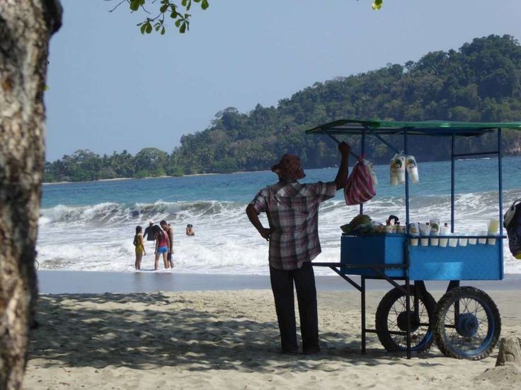 A vendor sells coconut drinks at a beach at Manuel Antonio, Costa Rica.