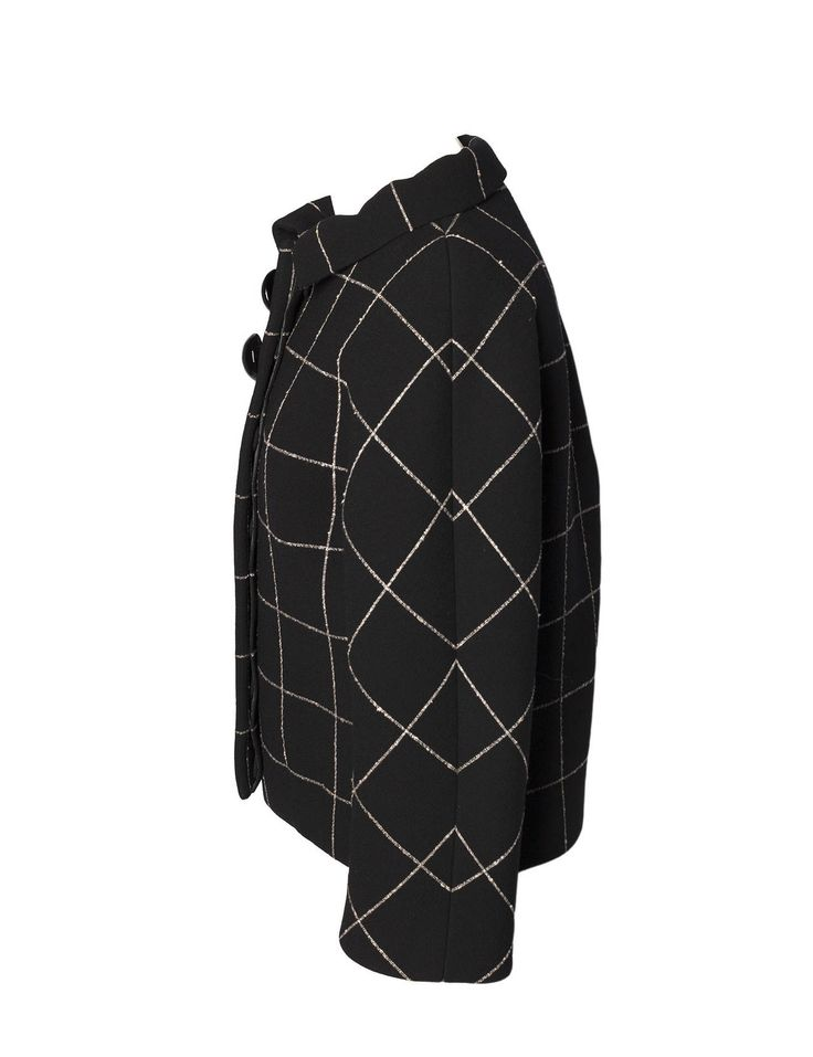 Balenciaga by Nicolas Ghesquière Fall 2006 Molded Check Tweed Jacket. Jacket is iconic couture shape with incredible details and finishes and is a must have for any collector of Vintage Balenciaga. Ghesquière's woman, in her amazing wardrobe of short, molded checked tweed suits with stand-away collars, rounded coats and mind-blowing wrought evening dresses, radiated a powerful modernity.