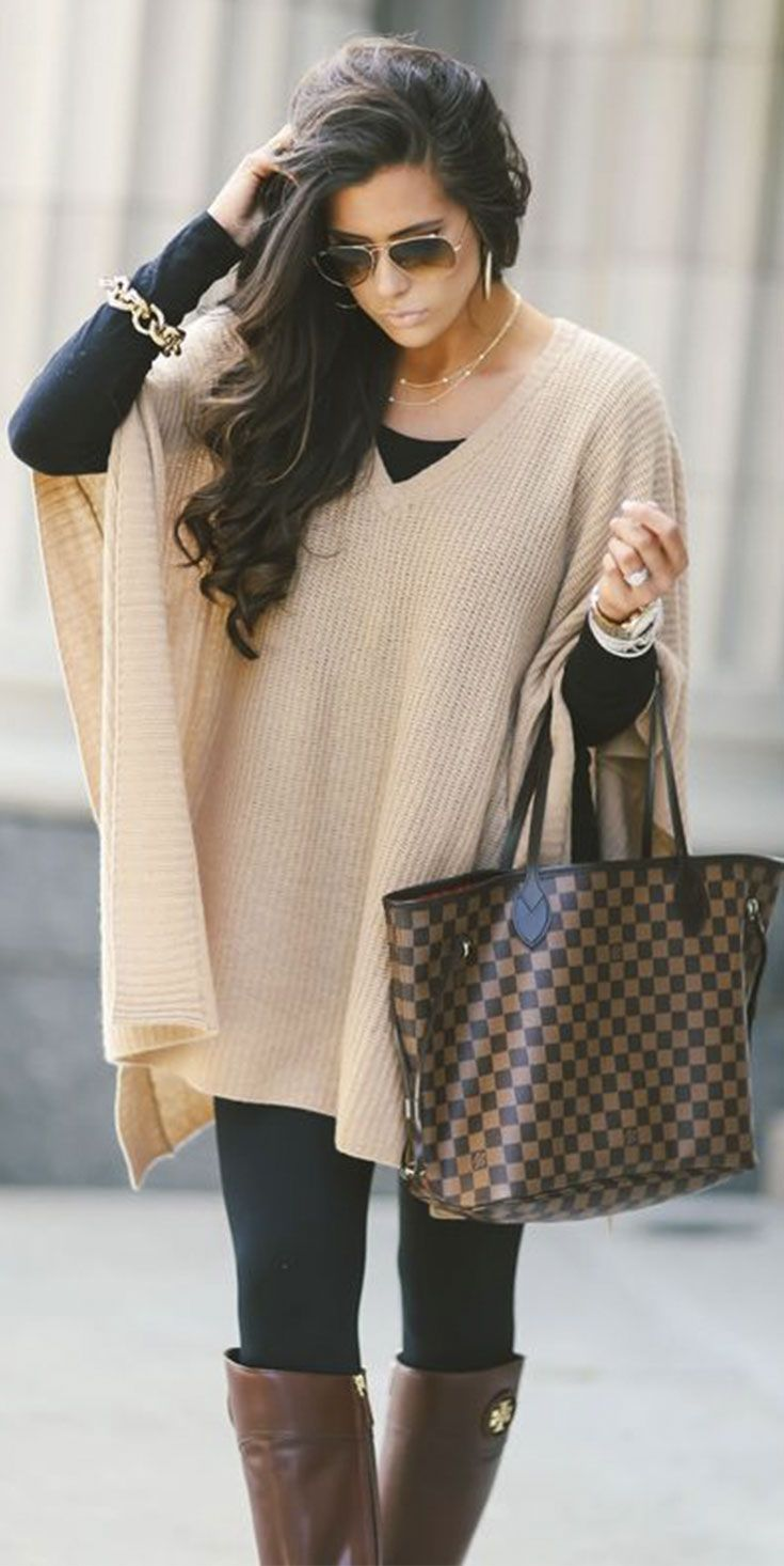 I like the layered look and long black top. Wouldn't like if the top was clingy.