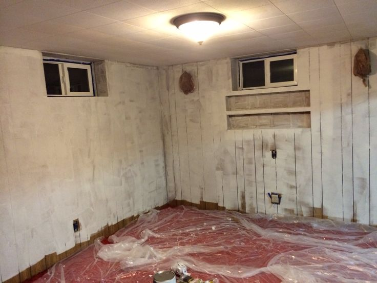 Our 70 S Basement After The Wood Paneling Has Primer On It