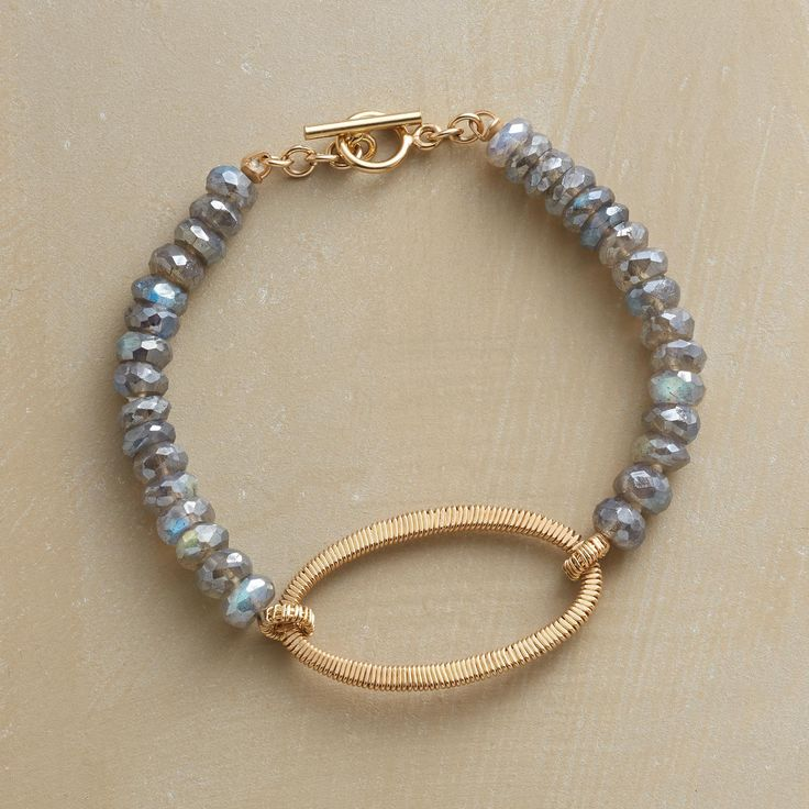 """MODERN KEEPSAKE BRACELET--Using an age-old wire-wrapping technique, Dana Kellin creates this deftly refined, keepsake-worthy bracelet combining the labradorite's shimmering elegance with 14kt gold filled wires. USA. 7-1/4""""L."""