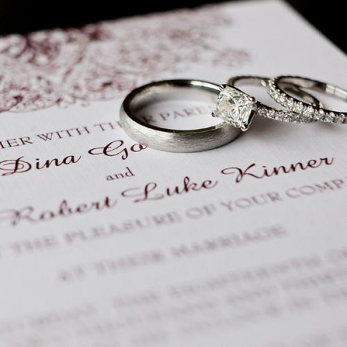 Real Weddings - In Bliss Weddings. Dina's engagement and wedding rings seen right, with Robert's ring seen left.