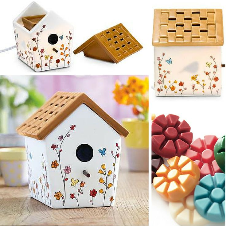 Birdhouse ScentGlow Warmer. A little bird has found a home in our sweet ceramic house decorated in a delicate butterfly and flower motif. Bird silhouette appears at the window when the Warmer is on. The thatched-style roof is a removable lid.