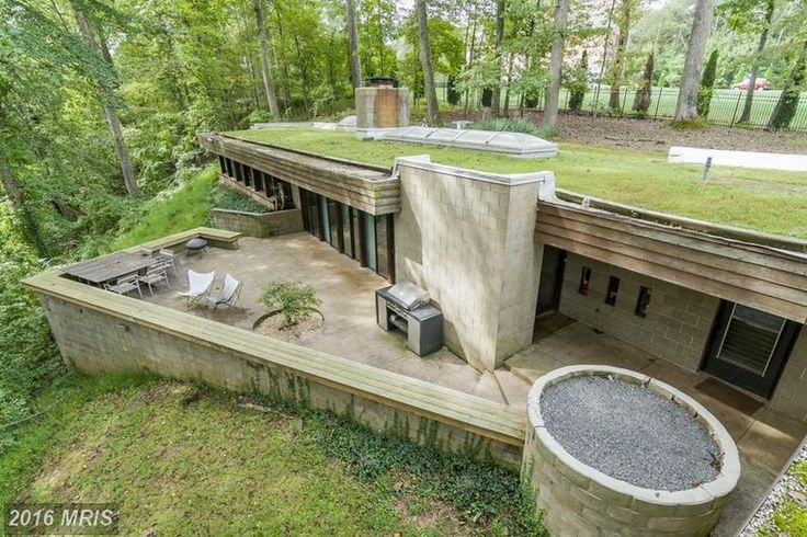For sale: $1,300,000. Rare opportunity to expand unique modernist home on 2.59 acres in McLean. Residence includes plans from architectDonald Reed Chandler to add a wing and additional footage to one of the nation~s first modern earth roof and berm homes. Made from concrete blocks and other natural materials, this 3BR/2BA home has soaring ceilings, giant windows, gourmet kit, deck & grass on the roof! Cul-de-sac.