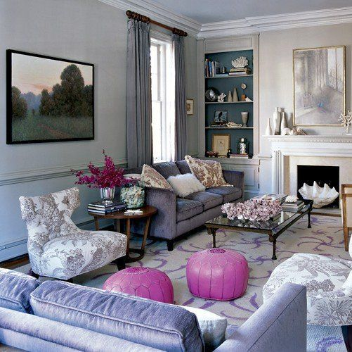 Grey living room with lavender velvet sofa and slipper chair. Second seating arrangement with a lilac sofa, fireplace.