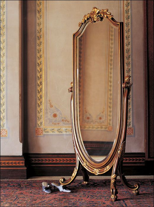 A lovely Italian style cheval mirror hand painted in antiqued medium brown finish and gold leafed accents