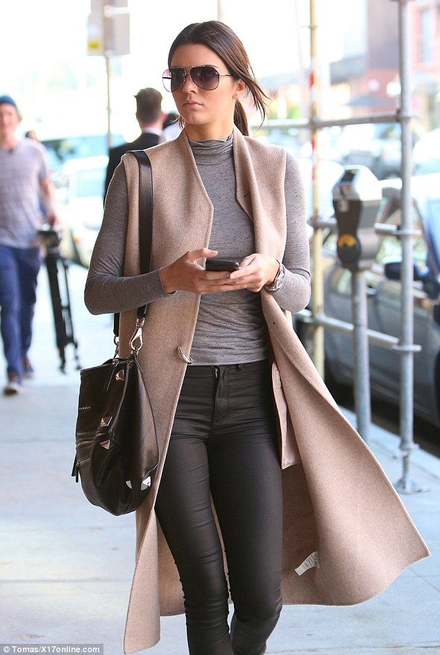 Classic: With her muted tones and conservative style - with just a little flair - Kendall sported a professional and classic look