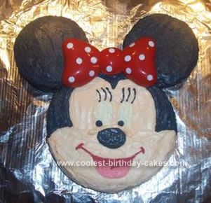 Homemade Minnie Mouse Cake: I wanted to make my daughter's first Minnie Mouse cake. I used two cake mixes and two different size pans. I used a bigger round cake pan for the face