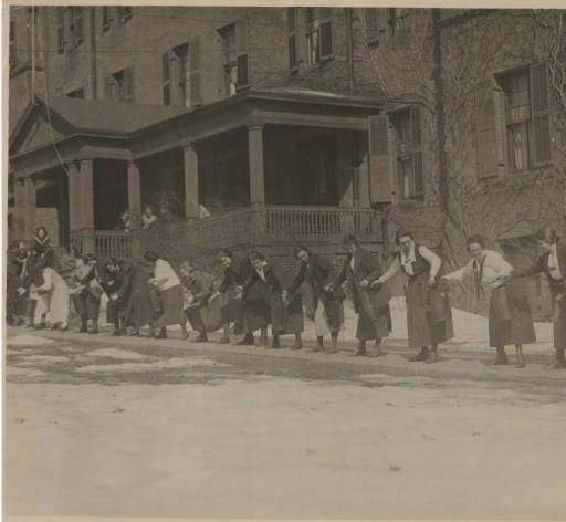 Students practice carrying buckets of water during a fire drill, October 1920 :: Archives & Special Collections Digital Images