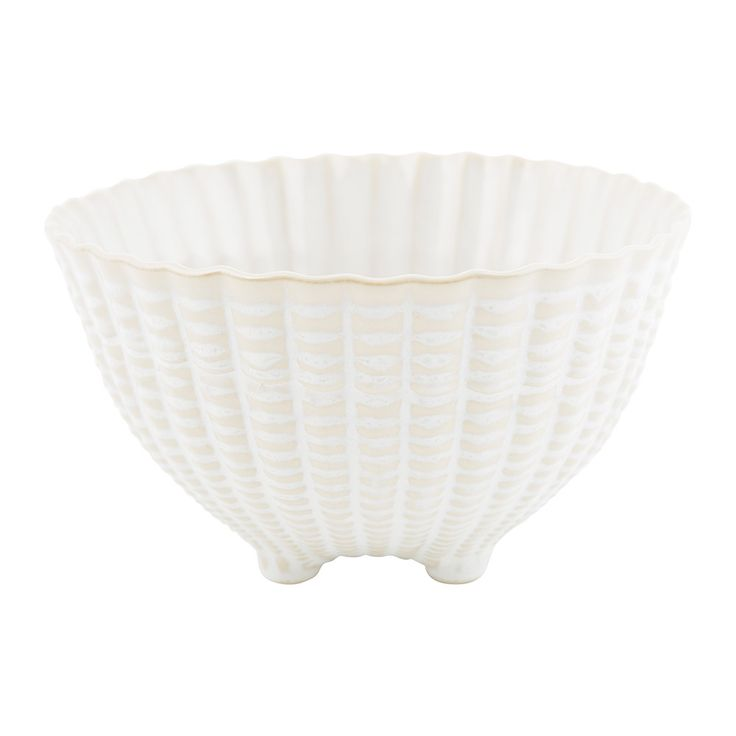Create an eye-catching table setting with this Triton salad bowl from Amara. Inspired by seashells the textured surface adds a nautical charm to an al fresco barbecue or informal dining setting. Made