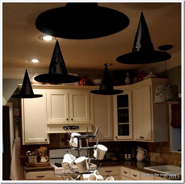 floating witchs' hats for halloween party.  great kitchen Halloween decor