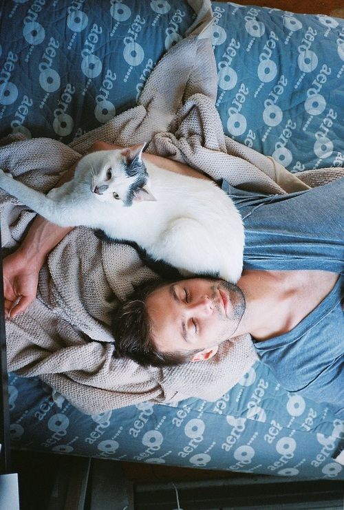 hot man with cat