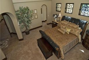 Mediterranean Master Bedroom with High ceiling, Bob Mackie Leather Sleigh Bed by American Drew, Carpet