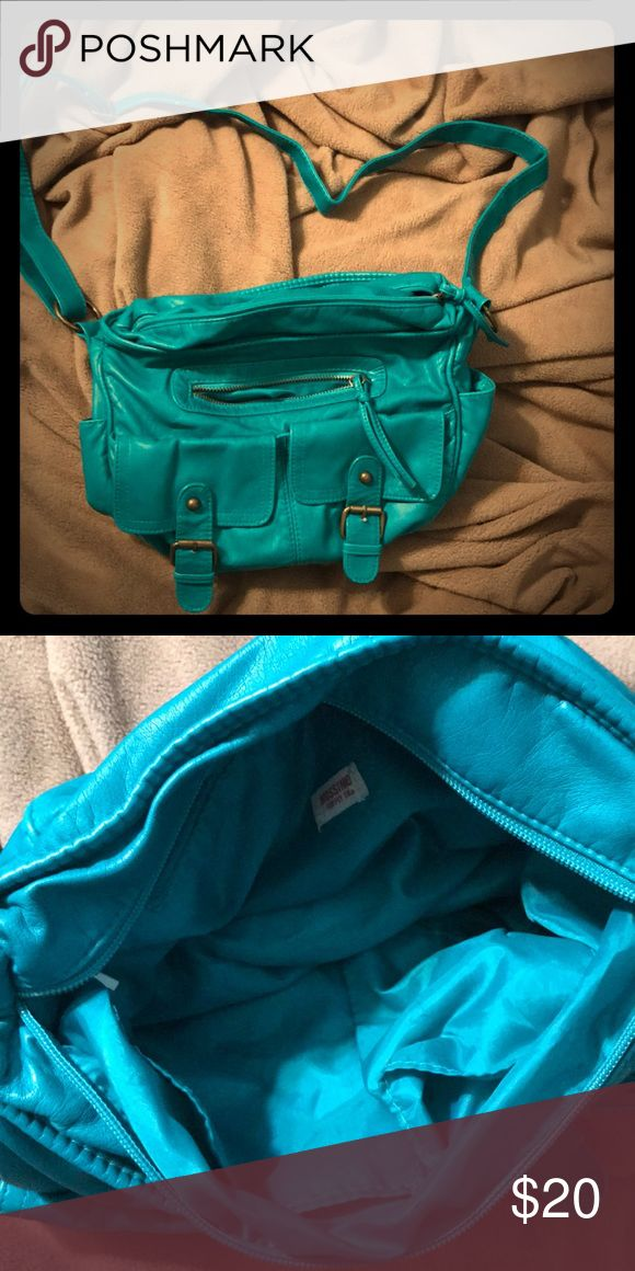 Turquoise Purse Beautiful turquoise purse! Has a cross body strap and many pockets for storage. Smoke free home! Photos make it look blue but it is more turquoise (like how the filter makes it look in the first photo). Mossimo Supply Co Bags Crossbody Bags