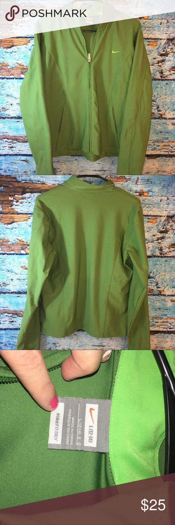 Nike fit dry large women's green Zip Up jacket Nike fit dry large women's green Zip Up jacket. Preowned in gently used condition with no visible signs of wear. Nike Jackets & Coats Utility Jackets