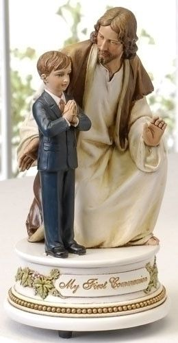First Communion Little Boy With Jesus Musical Figure The Lords Prayer. While Jesus kneels next to a young prayerful boy this wonderful music box plays the Lord