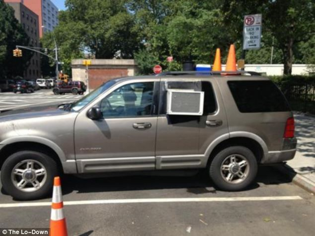 Inventive: This car fitted with a whole air conditioner has been spotted in the Lower East Side of New York City as the driver battles the never-ending heat wave scorching the East Coast