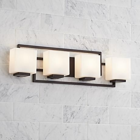 A 4-light vanity from the stylish, contemporary Lighting on the Square Collection by Possini Euro Design.