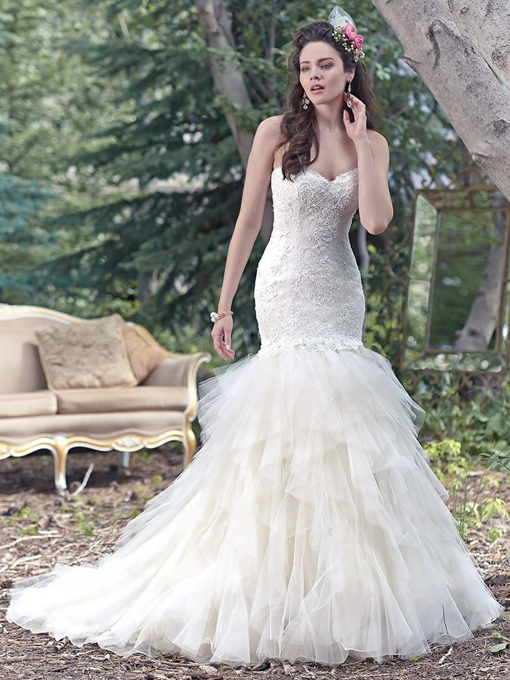 Stunning STORM Located in our Brunswick Emporium A gorgeous fitted lace bodice dotted with sparkling beading hugs the body of this fit and flare wedding dress